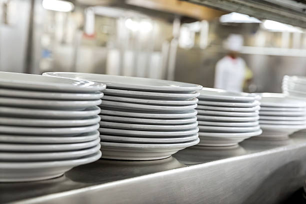 commercial kitchen showing dishes - commercial dishwasher stock photos and pictures