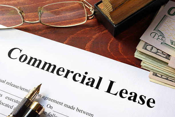 Commercial Lease agreement with money on a table. stock photo