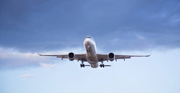 Commercial passenger jet airbus A350 of Quatar Airways landing at the airport. - foto stock