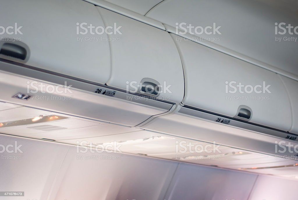 Commercial Passenger Jet Airplane Overhead Luggage Storage Compartment Bins royalty-free stock photo