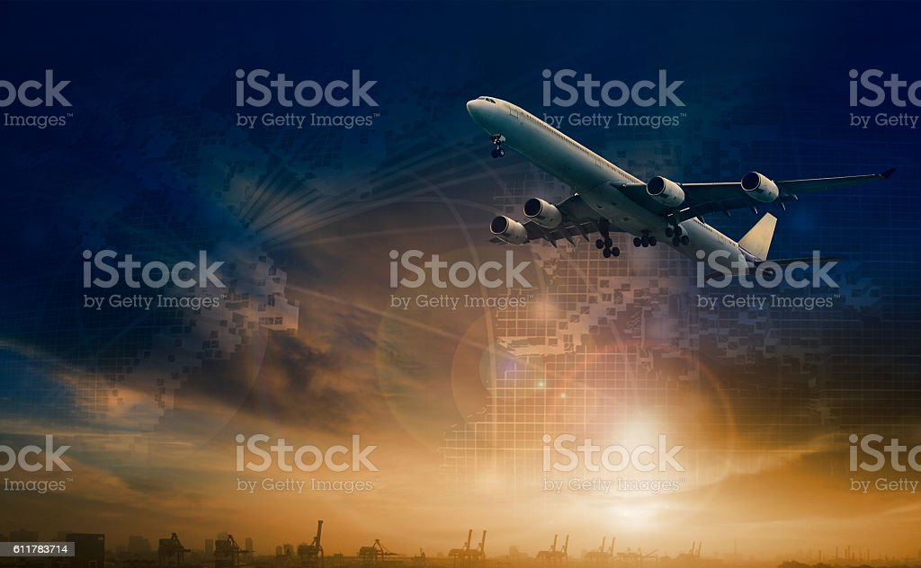 commercial plane flying over transport scene and freight stock photo