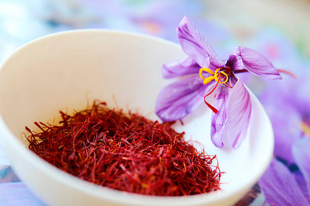 Commercial Saffron Commercial saffron comes from the bright red stigmas of the saffron crocus (Crocus sativus) which flowers in the Fall in many different countries, including Greece, India, Iran, Afghanistan and Spain. saffron stock pictures, royalty-free photos & images