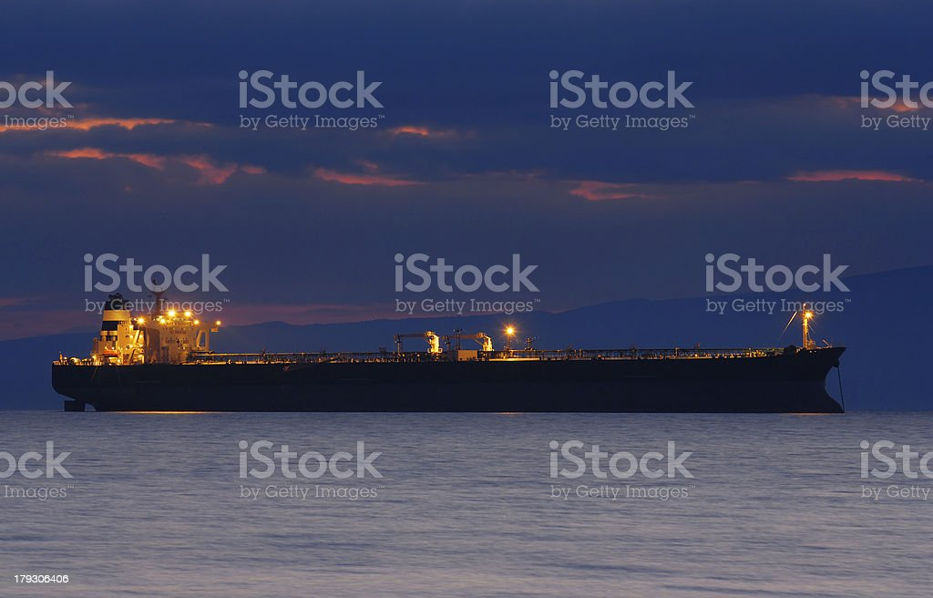 Commercial ship at dusk stock photo