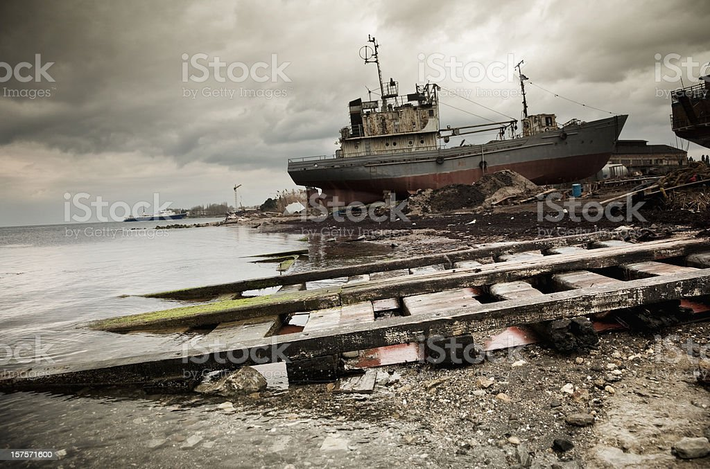 Commercial ship on the abandoned dock. Crisis in shipping industry royalty-free stock photo