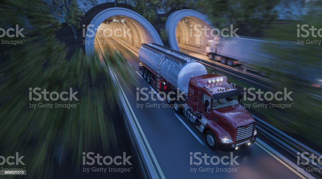Commercial Trucks Moving through Side by Side Tunnels royalty-free stock photo