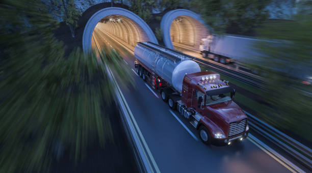 Commercial Trucks Moving through Side by Side Tunnels stock photo