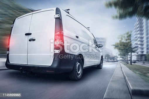 istock Commercial van driving quickly through the night 1145899965