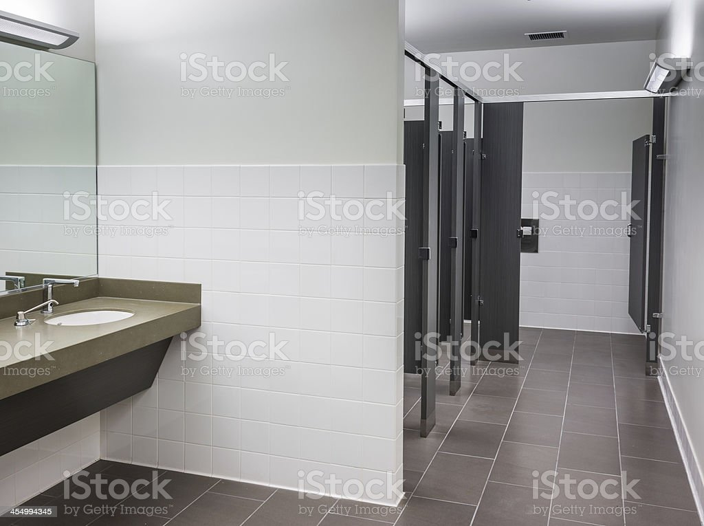 Commercial women's bathroom in neutral colors stock photo