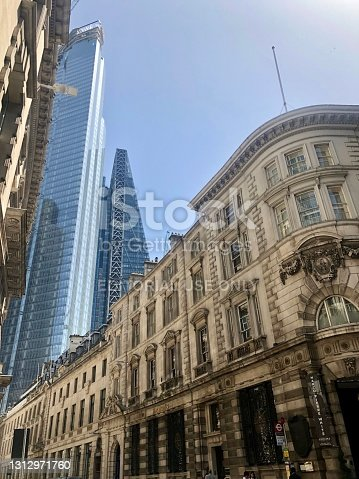 London, United Kingdom - June 29, 2019: Commerical office buildings contrasting classical and modern architectural designs in Cornhill