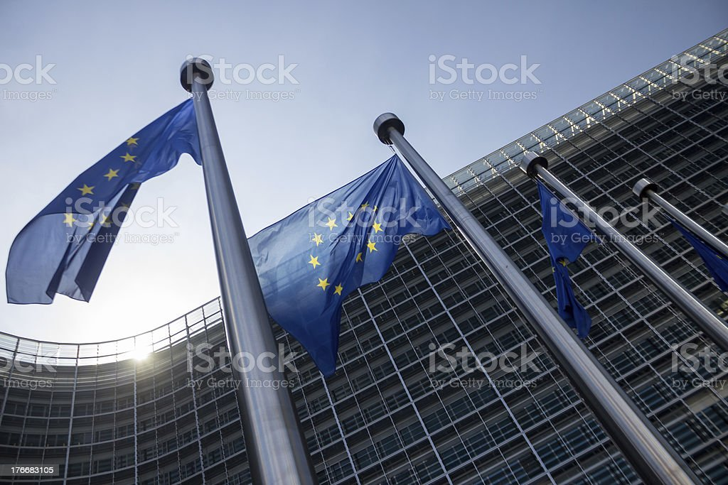 EU Commission building Europe Flags in Brussels stock photo