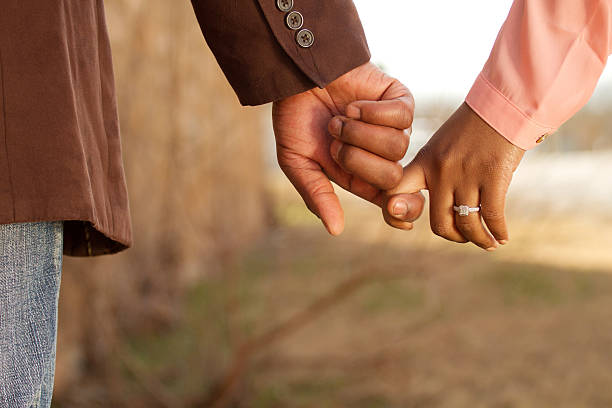 Engagement Couple holding hands honeymoon stock pictures, royalty-free photos & images