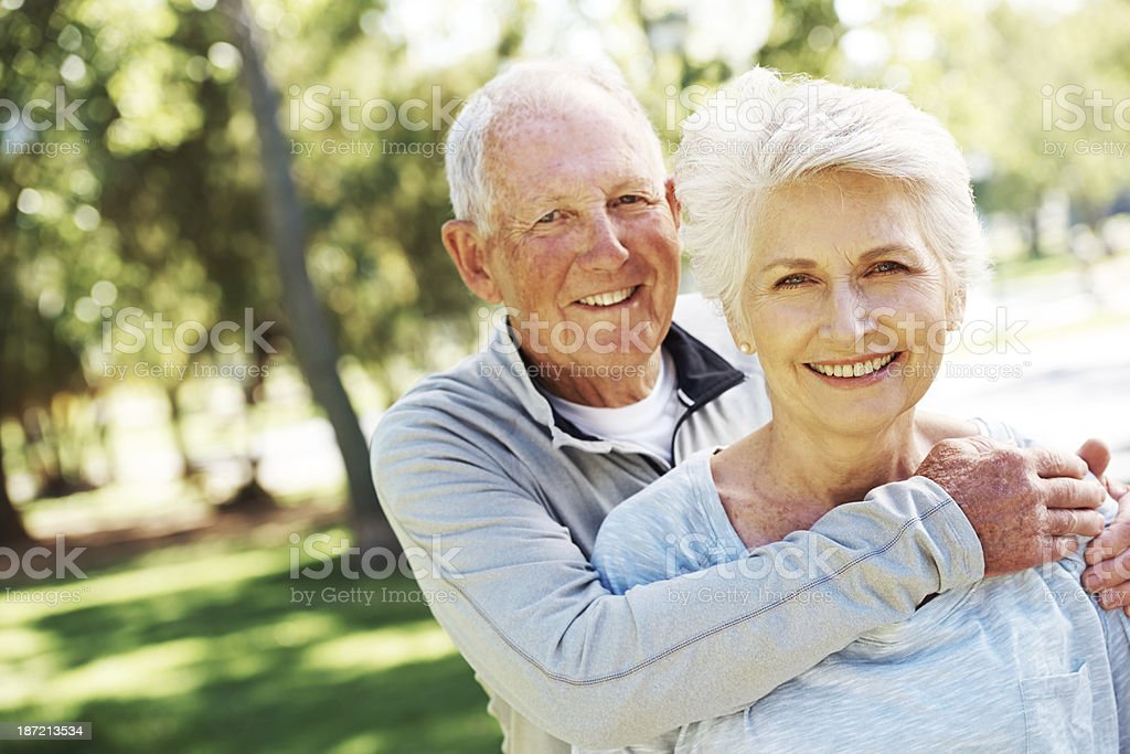 Committed to one another A happy senior couple relaxing together in their local park 60-69 Years Stock Photo