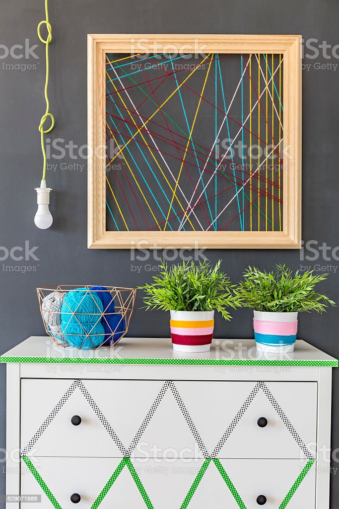 Commode with handmade wool decoration stock photo