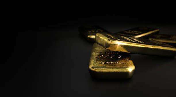 Commodities, Gold Bullion Bars Over Black - foto de acervo