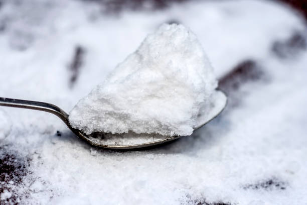 Common salt,Sodium chloride in a wooden scoop on wooden floor. Common salt,Sodium chloride in a wooden scoop on wooden floor. cobalt sulfate stock pictures, royalty-free photos & images