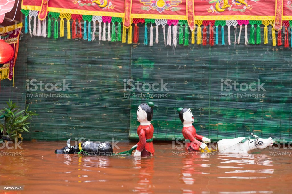 A common Vietnamese water puppetry show stock photo