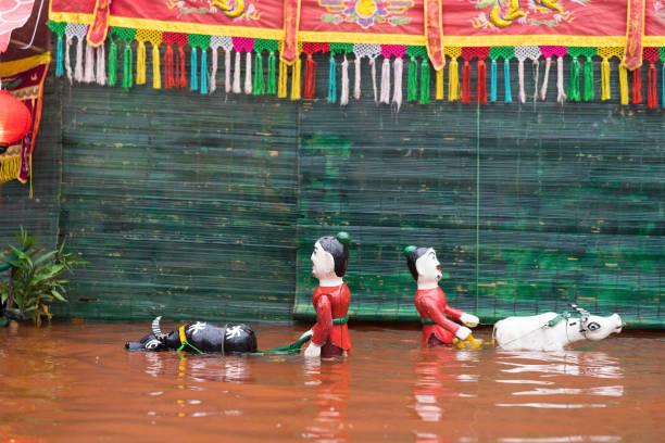Un spectacle de marionnettes vietnamiennes eau commune - Photo