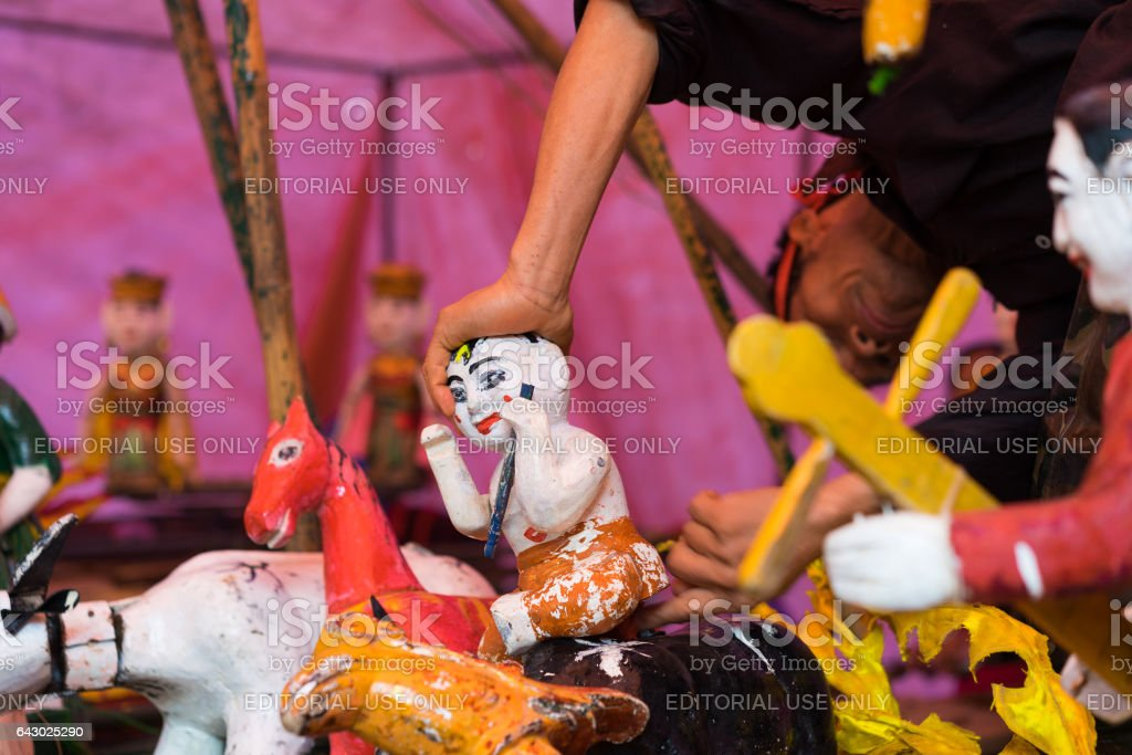 Hanoi, Vietnam - Feb 7, 2015: Common Vietnamese water puppets behind puppetry state at Vietnamese lunar new year festival organized at Vinschool, Vinhomes Times City, Minh Khai stock photo