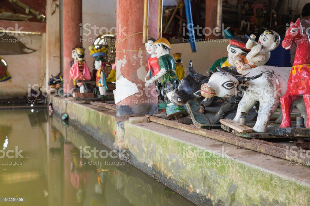 Common Vietnamese water puppets behind puppetry state in Dao Thuc village. The control room is dark to hide puppeteers and instruments stock photo