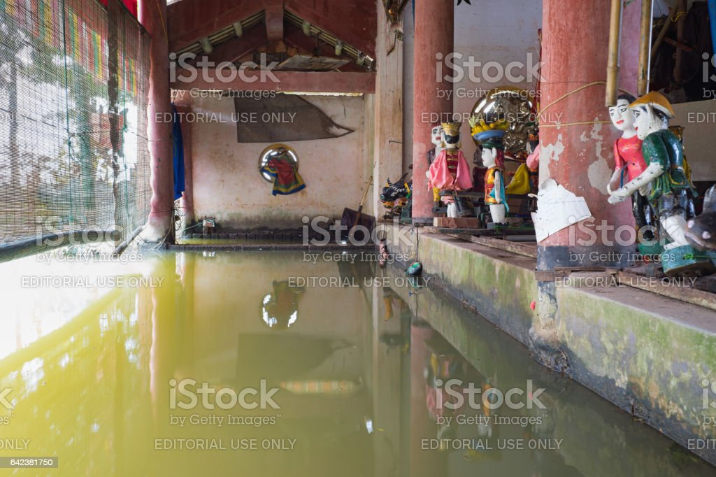 Hanoi, Vietnam - Sep 20, 2015: Common Vietnamese water puppets behind puppetry state in Dao Thuc village. The control room is dark to hide puppeteers and instruments stock photo