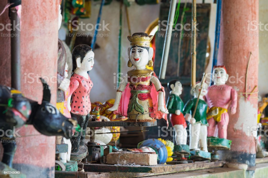 Common Vietnamese water puppets behind puppetry state. The control room is dark to hide puppeteers and instruments stock photo