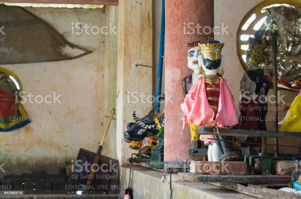 Hanoi, Vietnam - Sep 20, 2015: Common Vietnamese water puppets behind puppetry state. The control room is dark to hide puppeteers and instruments stock photo