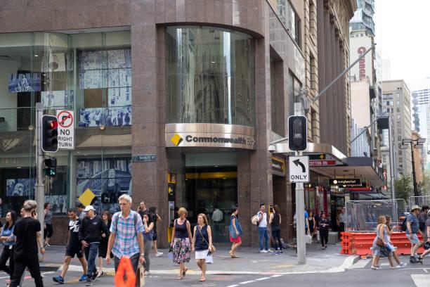Commonwealth bank on corner of  Margaret street, CBD area with crowd of people walking across street. Commonwealth bank is one of largest bank people use in Australia. Australia:15/04/18 stock photo