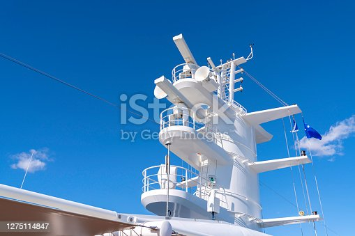 istock Communication antennas with navigation equipment, radar on the upper deck of the luxury white cruise ship. 1275114847
