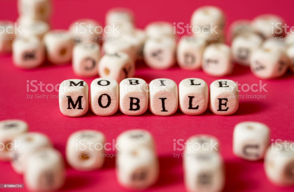 'MOBILE' communication browsing on internet and social network digital concept on red wallpaper. royalty-free stock photo
