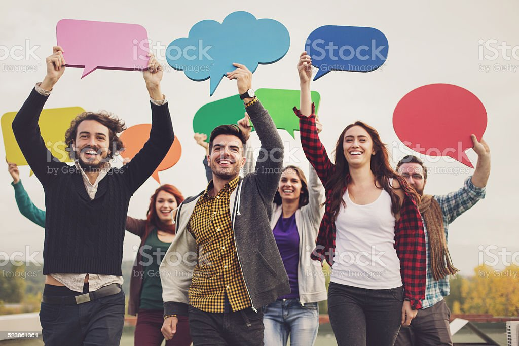 Communication concept with young people and bubbles stock photo