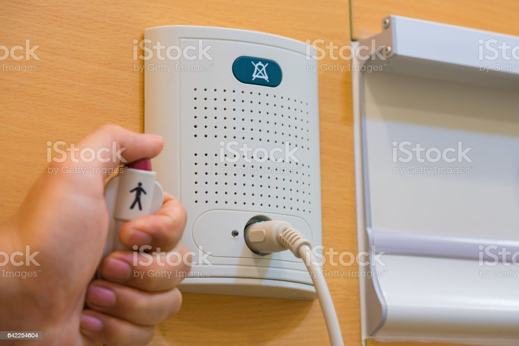 Communication device for contacting between patient and nurse or doctor in case of emergency or needing help in hospital stock photo