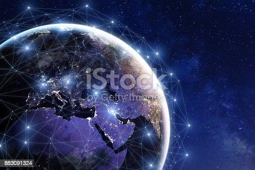 istock Communication network around Earth, worldwide international connections, finance, internet, IoT 883091324