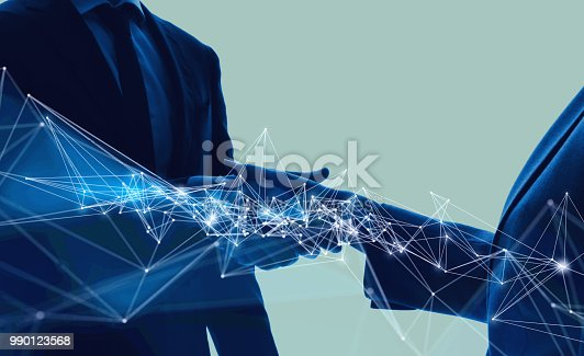 istock Communication network concept. Partnership of business. 990123568