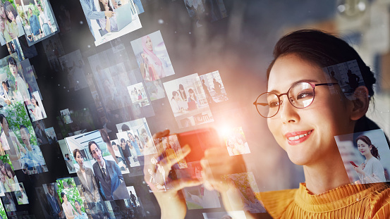 Communication network concept. Young asian woman in the office. Social networking service. Streaming video.