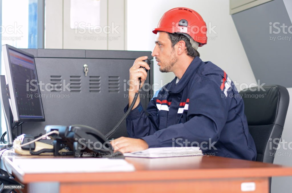 Communication operator talking on telephone in the office stock photo