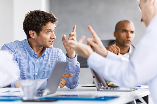 Frustrated entrepreneurs arguing during a business meeting in the office.
