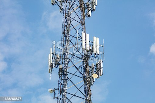istock Communication station. Antenna tower against clear blue sky background 1158266877