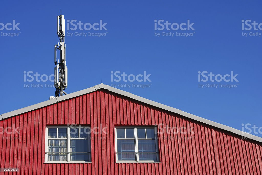 communication tower and red wall  Antenna - Aerial Stock Photo