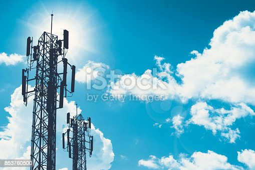 istock communication tower or 3G 4G network telephone cellsite silhouette on blue sky and space for text 853760500