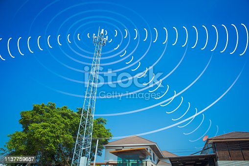 istock communication tower send and receive radio wave signal in the city concept. 1137759657