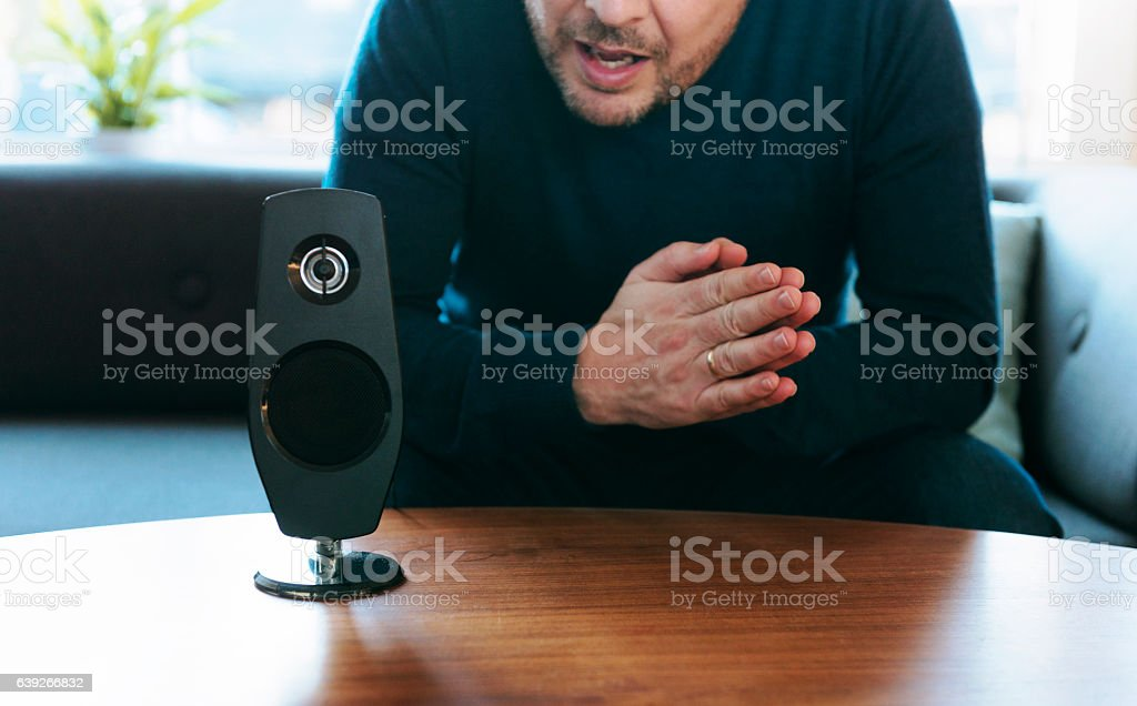 Communication with voice assistant in a smart home stock photo