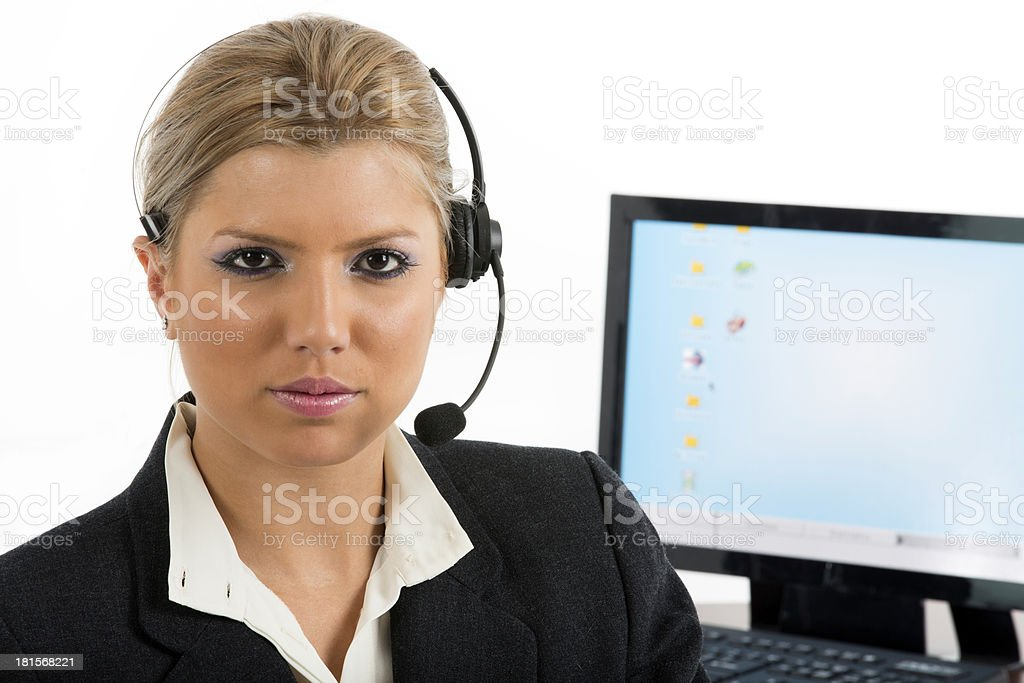 Communication: Woman talking on a headset royalty-free stock photo