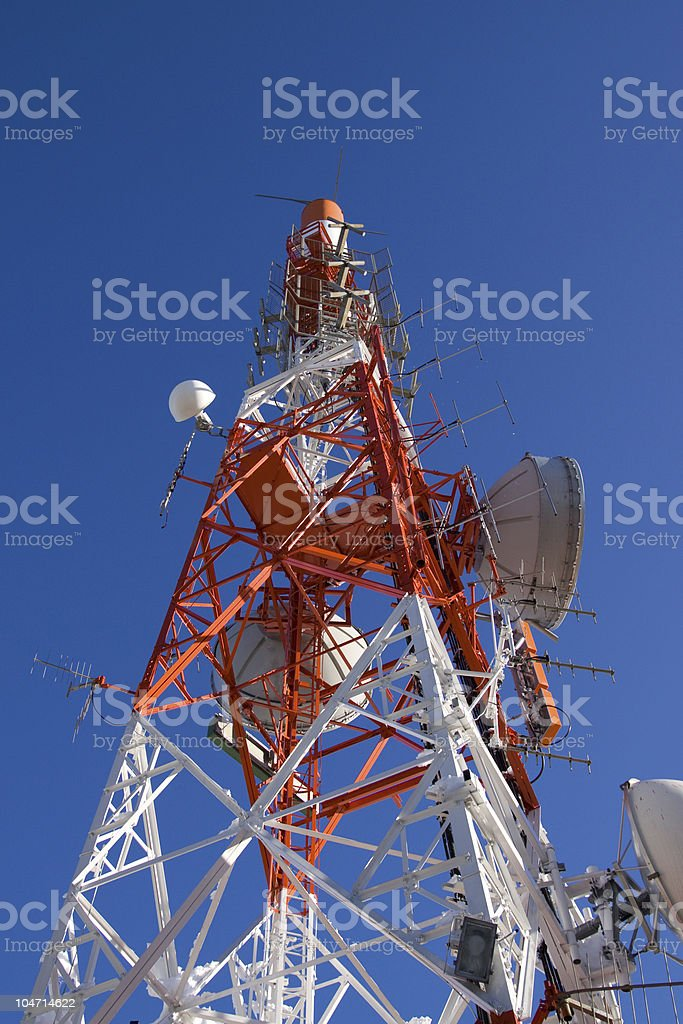 Communications Tower Against a Blue Sky, Technology Background stock photo