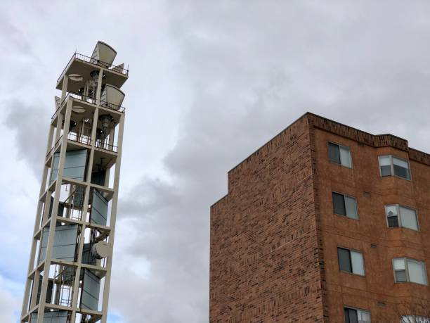 Communications Tower and Apartment Building on Cloudy Day stock photo