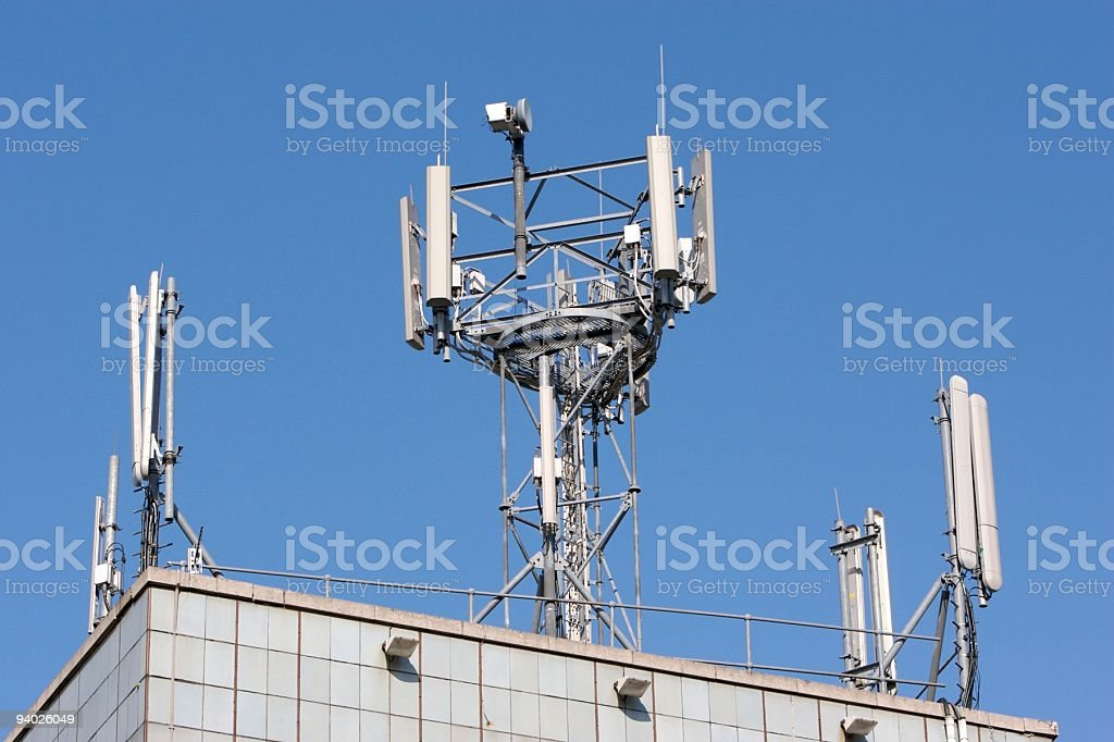 A communications tower in front of a blue sky stock photo