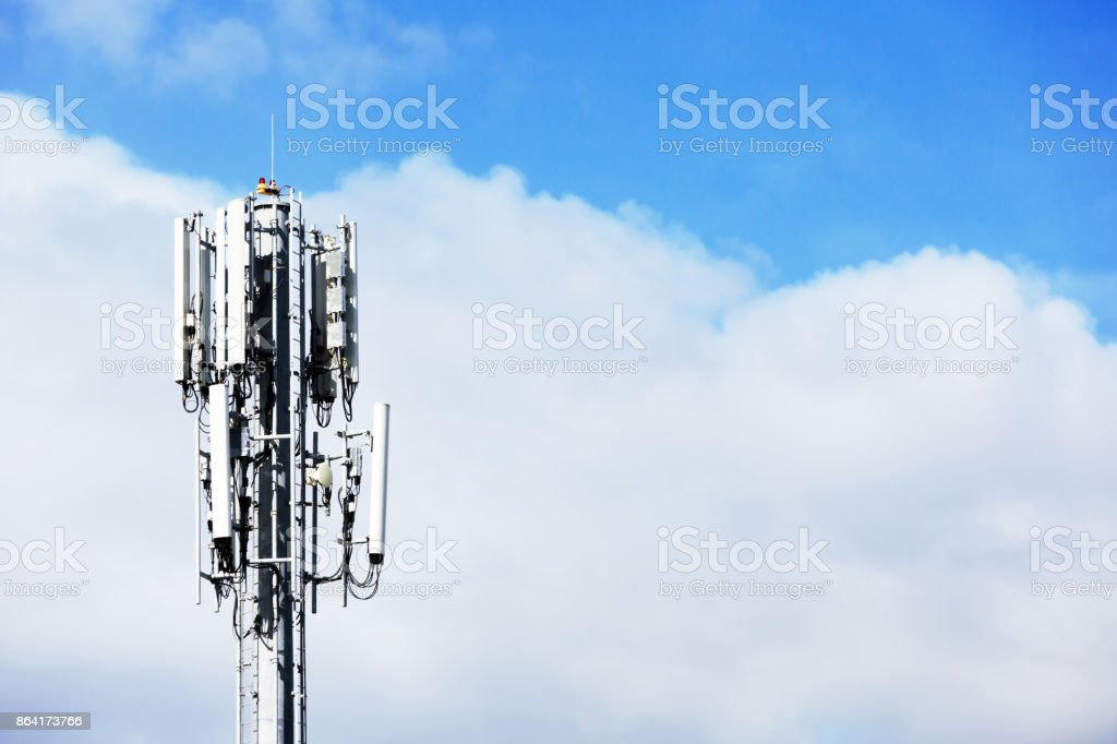 Communications tower rises against the sky royalty-free stock photo