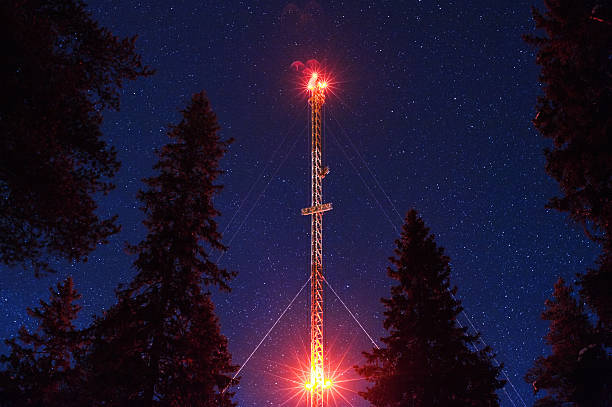 Communications tower under starry sky stock photo