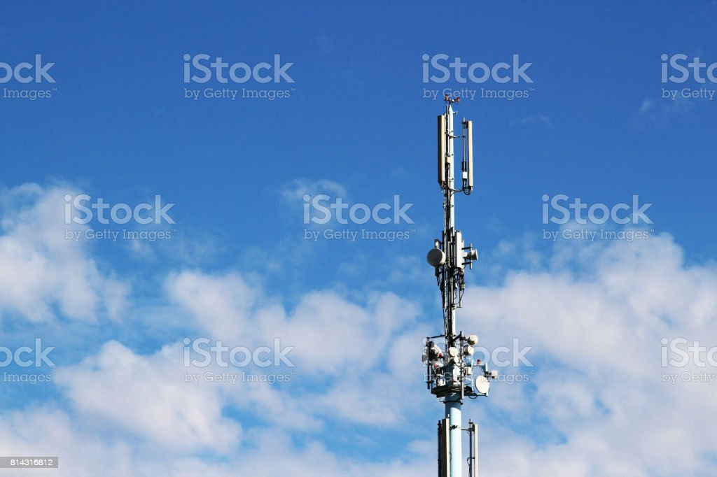 A communications tower with a sky background. stock photo