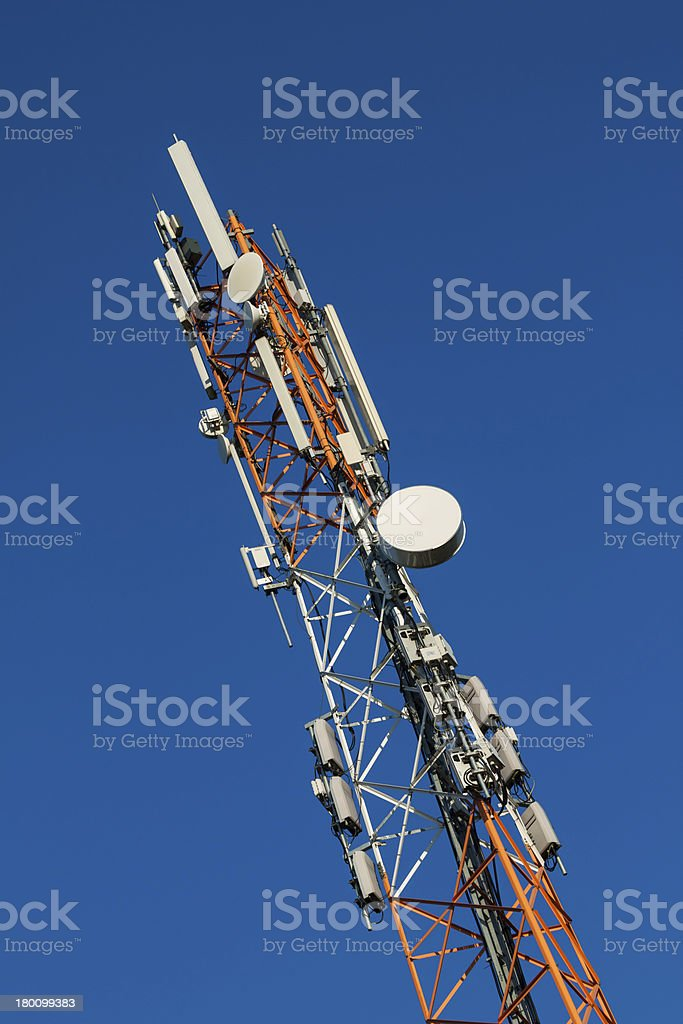 Communications tower with antennas on blue sky royalty-free stock photo