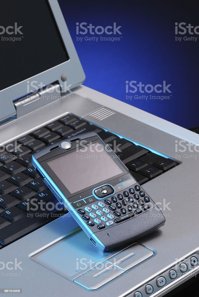 Communications with PDA and Laptop Computer royalty-free stock photo